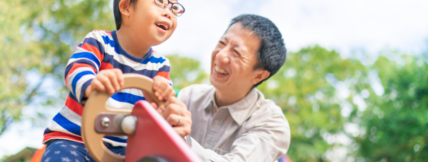 Child with down syndrome with his father